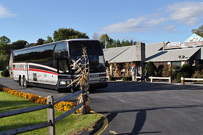 Group Tour Bus parked outside of Dakin Farm Market